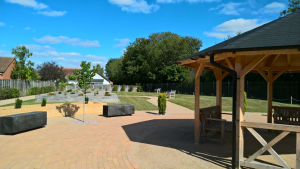A picture of the Memorial Garden, with Gazebo at the forefront